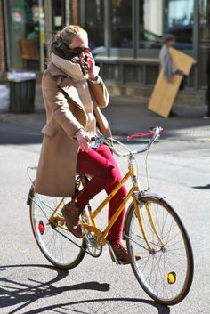 You have to love seeing things like this. She's looking great, riding a bike, avoiding traffic… and, on the phone.