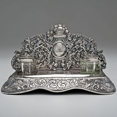 English, 19th century ornate Sterling Silver and Crystal Desk Standish, with two crystal inkwells on raised repoussé platform.