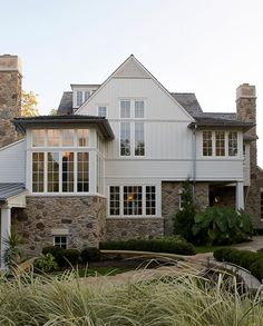 warmer white and white windows with white stone. i can drive you past this home