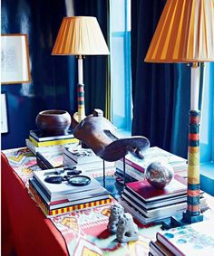 Cover a plain tablecloth with a vintage foreign textile and elevate exotic objects onto stands for an interesting vignette Dujour | Miles Redd