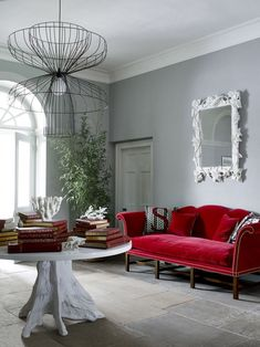 Charmant Grey Walls, Red Sofa.