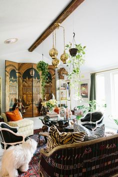 """Aldridge scored the ornate folding screen in her living room at Consignment Haven, one of her favorite stores in Dallas. After some time as a headboard and a few years in the garage, it now stands proudly in front of the fireplace. """"I pictured this whole new look for the space,"""" says Aldridge. (She typically changes up her decor twice a year.) Aldridge paired two '80s slipper chairs with 18th-century armchairs she reupholstered in black patent leather. The 1940s Thomasville sofa, once low..."""