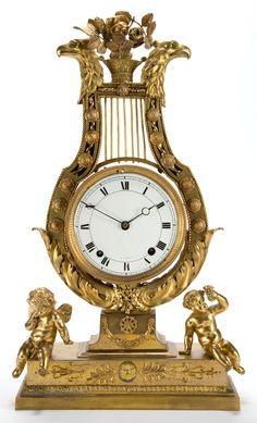 ❤ - A LEPAUTE FRENCH LOUIS XVI-STYLE GILT BRONZE LYRE-FORM CLOCK. Pierre-Henry Lepaute, Paris, France, circa 1800-1825.