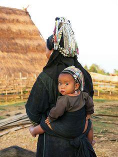 Akha lady and her baby . New Pei Yesang village . Laos