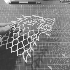The prototype cut for the Stark Banner I made. House Stark dire wolf from Game of thrones. Handmade papercutting.