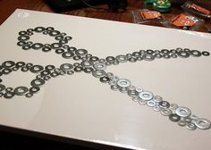 This is so cool!!! Washers, on canvas, in any shape or letter... Sooooo many ideas now!!!