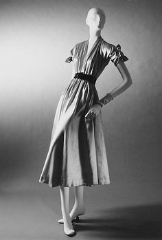 """""""Aladin""""  House of Dior (French, founded 1947)  Designer: Christian Dior (French, Granville 1905–1957 Montecatini) Date: fall/winter 1947–48 Culture: French Medium: (a) silk (b) patent.  Credit Line: Gift of Bettina Ballard, 1958.  I LOVE the sweet drapery of the skirt and the sleeve tie bows on the shoulder, SO cute!!!"""