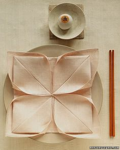 Lotus Napkin Fold - Also called the water lily or the artichoke, this is one of the best-known napkin folds and will be familiar to anyone who ever made a paper fortune teller as a child. Use it to present dinner napkins or to surround a roll, a party favor, or a flower.
