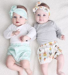G&J wearing our Mint Feather bloomers and our Multi-Feather bloomers with matching headbands. Made from organic materials with beautiful hues of coral, mint, yellow and browns.