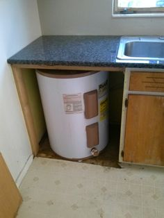 kitchen under cabinet heating water heater in kitchen cabinet or buy a big one and 22090