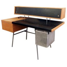 George Nelson Office Desk for Herman Miller 1948 USA 1948 From George Nelson's ground breaking 1948 group of designs for Herman Miller that put the company firmly in the ranks of post war modernism. Nelson's desk was decidedly futuristic, with the floating cabinet above the desktop, containing numerous shelves, dividers, and drawers behind leather clad sliding doors. The work surface is also in black leather, and features a flip up compartment meant to house a mounted typewriter, $16000