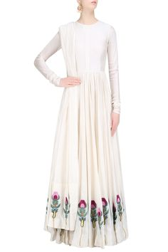 Description Featuring an off white flared kalidaar anarkali gown in cotton silk base embroidered with multicolor silk thread and zari floral motifs around the hem of ghera. It comes along with an off white cotton silk floral motifs dupatta. FIT: Cut for relaxed fit. COMPOSITION: Cotton silk. CARE: Dry clean only.
