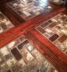 Wood inlay with brick floor by portstone.com. I would love something like that for a converted barn.