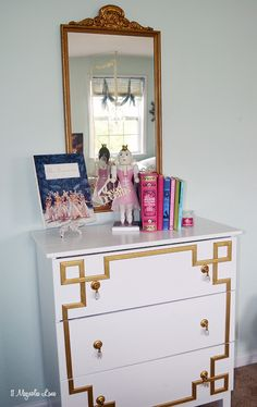 Vintage gold mirror from a Savannah antique shop hangs over a DIY gold Greek key dresser (made from an IKEA dresser!). Perfect for a young girl's bedroom.