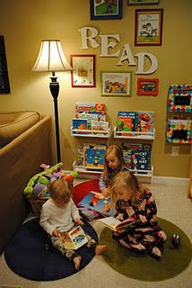 Here is a #reading nook for the entire family.  In the family room, set up a corner for the kids, right behind the sofa or dad's reading chair.  Make sure each child has their own small rug (stops fighting).  Put their books on shelves facing out like the ones shown (they will choose books easily).