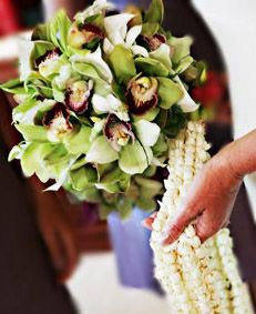 BOUQUET STYLE: tropical hand-tied of green cymbidium orchids and cascading pikake leis---heavenly scent