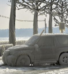 An ice-covered car beside Lake Geneva in Versoix, Switzerland, Feb. 4.