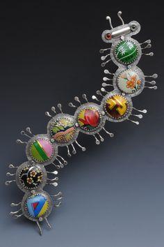 Susan Skinner, artisan jeweler; sterling silver, tin, glass.