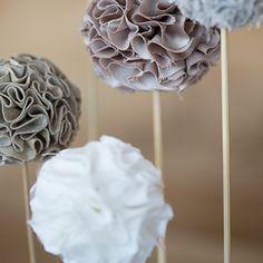 Des pompons en tissu