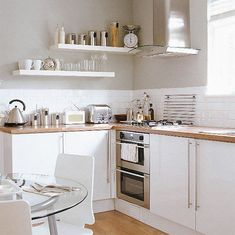 I'm in love with this color combination: white, light grey and wood