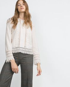 Image 1 of SWISS DOT BLOUSE WITH LACE TRIM APPLIQUÉ from Zara