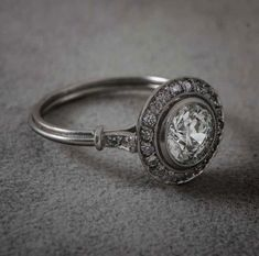1.49ct Diamond Engagement Ring surrounded by a halo of diamonds and set in handmade platinum. A beautiful and marvelous Art Deco Style Ring.