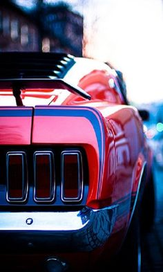 Old, red mustang.  My dream car <3