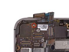11. Fjern den 1.6 mm Philips-skrue, der holder logic-boardet ved tænd-knappen.