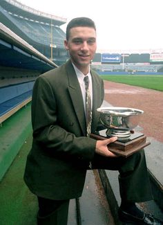 NOV 1996 - Yankees shortstop Derek Jeter is the unanimous choice as American League Rookie of the Year. He is the eighth Yankees player to win the award and the fifth unanimous choice in American League history. Yankees Baby, New York Yankees Baseball, New York Giants, Baseball Dugout, Baseball Cleats, Derek Jeter, Baseball Games, Baseball Players, Baseball Stuff