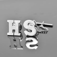 A personal favourite from my Etsy shop https://www.etsy.com/hk-en/listing/262366967/initial-tie-tack-tie-pin-tie-clip