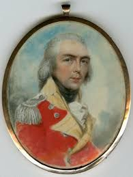 """A miniature portrait of Captain John Brock, 81st Regiment of Foot. There is an inscription on parchment attached to the reverse which reads """"Major Gen. Sir Isaac Brock Lieut. Govenor of Upper Canada Fell at Queenston Heights on 13th Oct 1812"""" """"The Hero of Canada"""". Above this inscription is a picture of an Indian on a battlement, holding what appears to be a tomahawk. Directly below this picture is a banner with the word """"Canada"""" on it."""