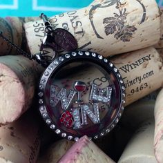Origami Owl Black Crystal Locket with Silver Wine Glass and Grape Charms as Well as Crystal Letter Charms spelling Wine