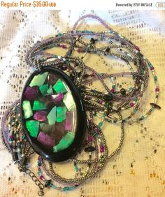 A personal favorite from my Etsy shop https://www.etsy.com/listing/236477651/on-sale-vintage-confetti-lucite-abalone