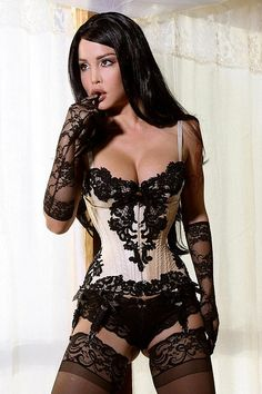 black and cream vintage corset [ book inspiration: fabric, lace, seam & stitching details, bones, laced, ribbon (?), grommets (?), spaghetti straps, garter closure (?), or garter closure to secure an inside pocket ]
