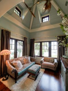 Master bedroom sitting area - love the blue vaulted ceiling & the blue edging on the sofa and ottoman!