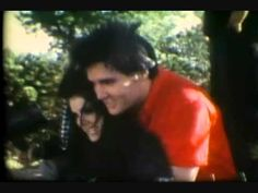 A video of Elvis, Lisa and Priscilla playing along with the song DANCE WITH MY FATHER, AGAIN   It is not sung by Lisa or Elvis but is beautiful all the same.    Yes!  I would love to Dance with my father again, also.