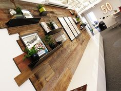 Reclaimed Wood Feature Wall and Custom Branded Lightbox. Interiors by SHOPHOUSE…