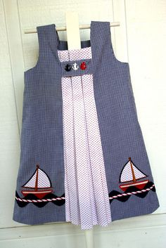 "Sailboat applique dress    Pattern I used to make this is ""Birthday Party Dress"" by Oliver + S. Both fabrics are by Fabric Finders. Embroidery applique design is from www.emblibrary.com  Materials to make this dres are available from www.sewblessedfabric.com (email the shop for a kit)"