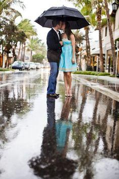 Beautiful rainy engagement photo by Sara Kauss Photography  we ♥ this! davidtuteraformoncheri.com