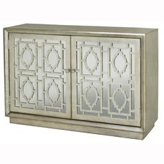 This hand painted distressed silver finish mirrored accent chest features two doors with an adjustable shelf inside. The chest offers nickel finish hardware