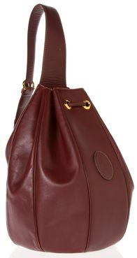 CARTIER HANDBAG - This leather handbag is seasonally chic for summer strolls.