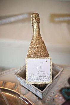 DIY New Years Eve Ideas-Cover Champagne Bottles in Gold Glitter