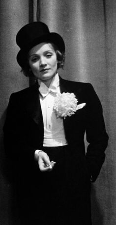 """""""The Dyke Look"""" Marlene Dietrich Wearing Tuxedo Top Hat Corsage and Holding Cigarette Foreign Press Ball by Alfred Eisenstaedt Marlene Dietrich, Old Hollywood, Classic Hollywood, Hollywood Icons, Divas, Pin Up, Dangerous Woman, Suits For Women, Movie Stars"""