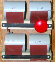 Sandpaper Dispenser by Tim Pettigrew -- Have just made myself a sandpaper dispenser for sanding lathe work which both makes the various grades accessible and dispenses by using tear-off plates made from old hacksaw blades. Adapted from an original idea which once appeared on the Laymar Crafts website. Click for construction...