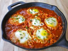 Shakshuka This is a simple, comforting Israeli dish of eggs poached in spicy tomato sauce. To make it, I sautee onions, garlic, and peppers in olive oil with cumin, paprika, salt, and pepper, 'til softened, and then add a large can of whole plum tomatoes (undrained). This is simmered for a while, and then eggs are cracked in to poach in it. This can be served with crumbled feta and chopped parsley on top, or just as it is, with toast or pita bread on the side.