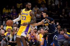 0afaa1671ce LeBron James in his debut match with Lakers ended up in a loss of against  the Denver Nuggets in the pre season match. LeBron made his Lakers debut  from the ...