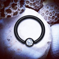 ♥ www.throwbackannie.com ♥ Black Simple CBR with Jewel / Jewelled Captive Bead Ring ♥ ♥ Super CUTE jewelry body piercing rings are a must have!  This piercing can be used for a variety of body piercings including nipple rings, helix earring, septum piercing, rook piercing, anti tragus , snug ring, cartilage ring, lip ring and black earrings for celebrity style fashion photography and winter fashion! Love body piercings all year round from www.throwbackannie.com! Multiple ear piercings kylie
