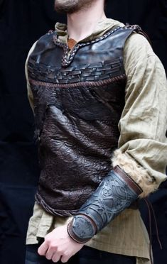 One-of-a-kind Leather armor viking inspired, jacket style light armor. Black leather hand dyed and stitched chest piece.