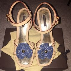 """AUTHENTIC Louis Vuitton Freesia Platform Sandal AUTHENTIC Louis Vuitton """"Freesia Platform Sandal"""" size 37.5 = US size- 7.5 VERY HARD TO FIND! Gorgeous Louis Vuitton sandals can be worn to formal & casual occasions. They are crafted from wood with criss cross straps & monogram denim fabric flowers at the vamps. They feature adjustable ankle straps, leather lined cushion insoles & 9cm heels. *They are in excellent condition, besides a minor scuff on the right heel. LV will send them out to the…"""