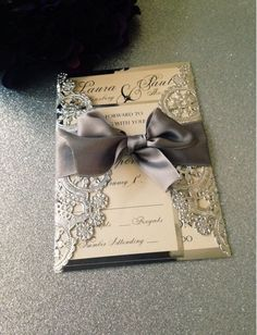 This is exactly the kind of style I want my wedding invitations be - only in gold and the ribbon would be deep purple.